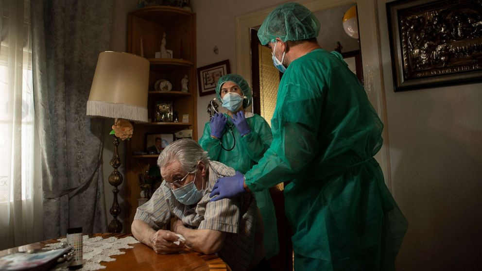 PHOTO: A nurse provides cares to a patient during a house call visit in Barcelona, Catalonia, north eastern Spain, May 23, 2020.