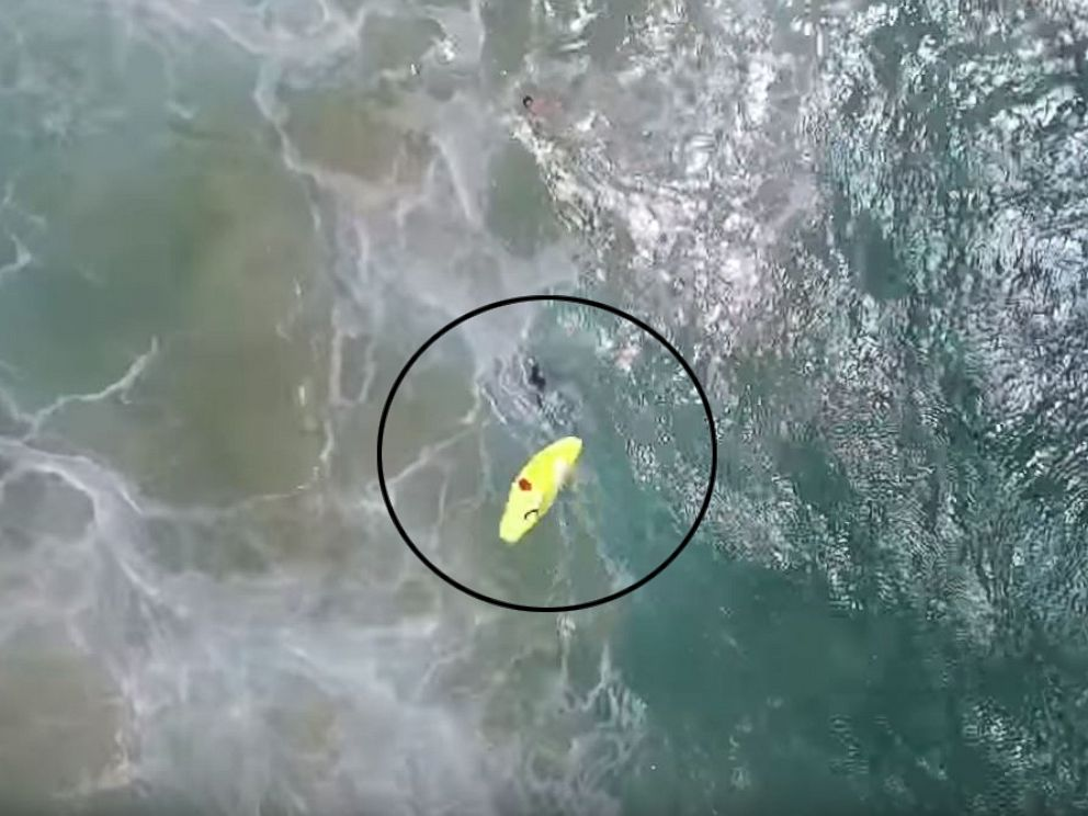 PHOTO:A drone deploys an inflatable life raft for two swimmers at Lennox Beach, north of Ballina, Australia.