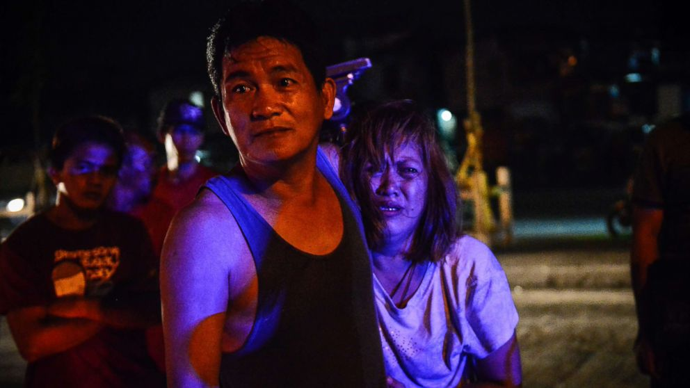 The parents of Irish Glorioso weep after learning their son was shot dead by unknown assailants in Navotas, north of Manila, Philippines, June 8, 2017. Drug-related killings continue as President Rodrigo Duterte marks his first year in power.