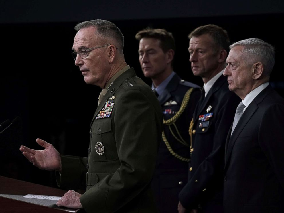 Joint Chiefs of Staff Gen. Joseph Dunford left and Defense Secretary Jim Mattis right brief members of the media on Syria at the Pentagon
