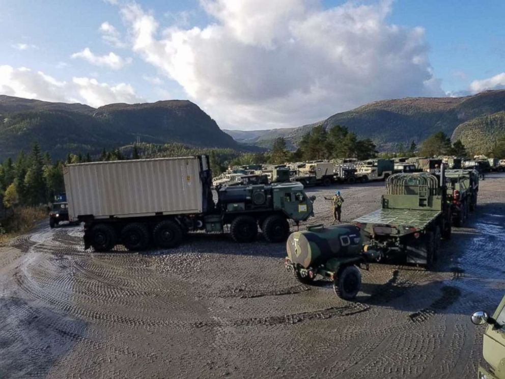 PHOTO: U.S. Marines with II Marine Expeditionary Force, standby to off-load equipment for NATO exercise Trident Juncture from ARC Resolve in Hammernesodden, Norway, Sept. 23, 2018.