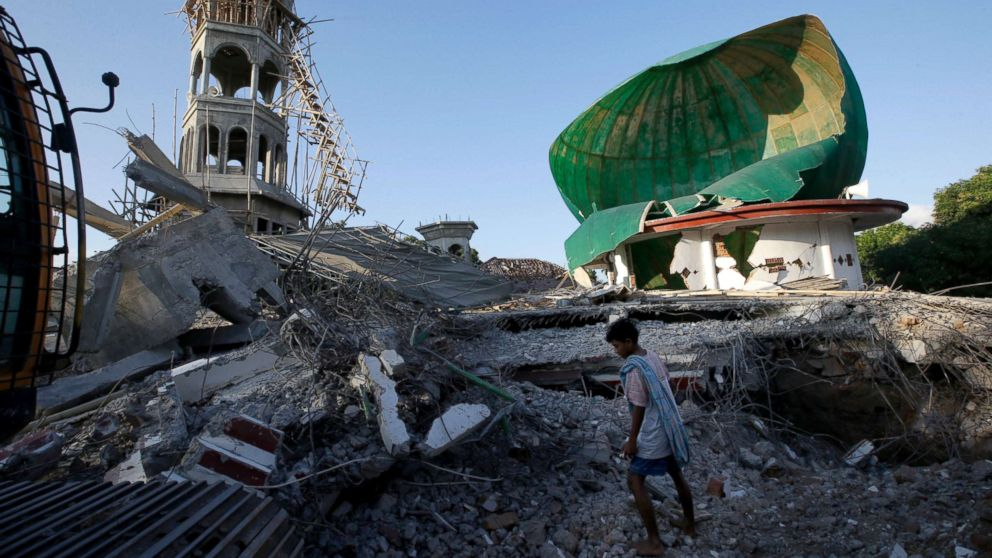 A resident inspects a mosque damaged by an earthquake in North Lombok, Indonesia, Aug. 7, 2018. Thousands left homeless by the powerful quake that ruptured roads and flattened buildings on the Indonesian tourist island of Lombok sheltered Monday night in makeshift tents as authorities said rescuers hadn't yet reached all devastated areas.