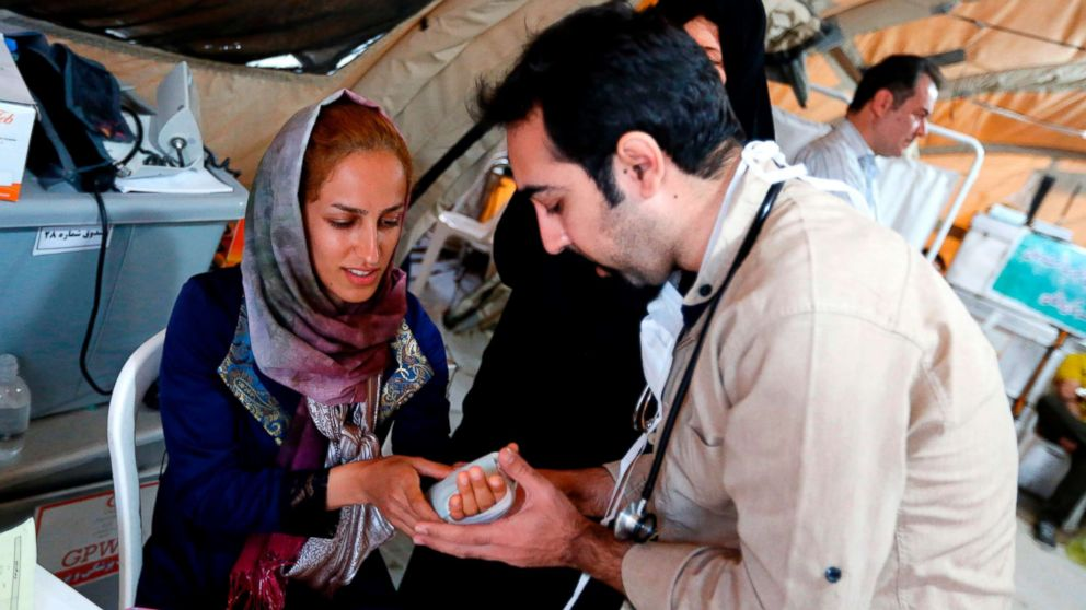 Medics attend to quake victims at a field hospital in the town of Sarpol-e Zahab in the western Kermanshah province near the border with Iraq on Nov. 14, 2017.