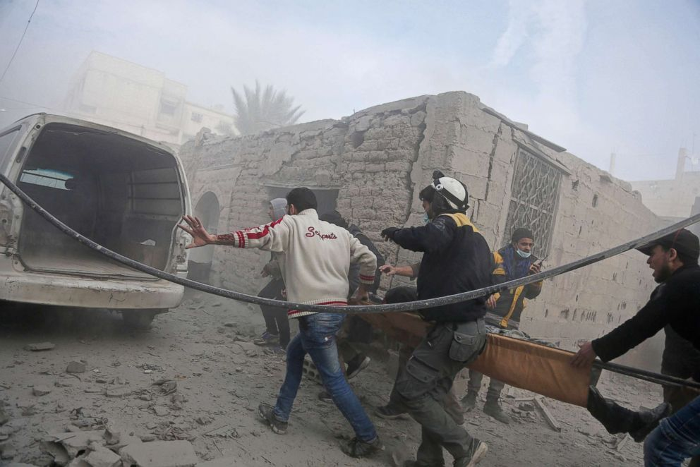 PHOTO: Members of the Syrian civil defence evacuate an injured civilian on a stretcher from an area hit by a reported regime air strike in the rebel-held town of Saqba, in Eastern Ghouta on the outskirts of Damascus, Syria, on Feb. 20, 2018.