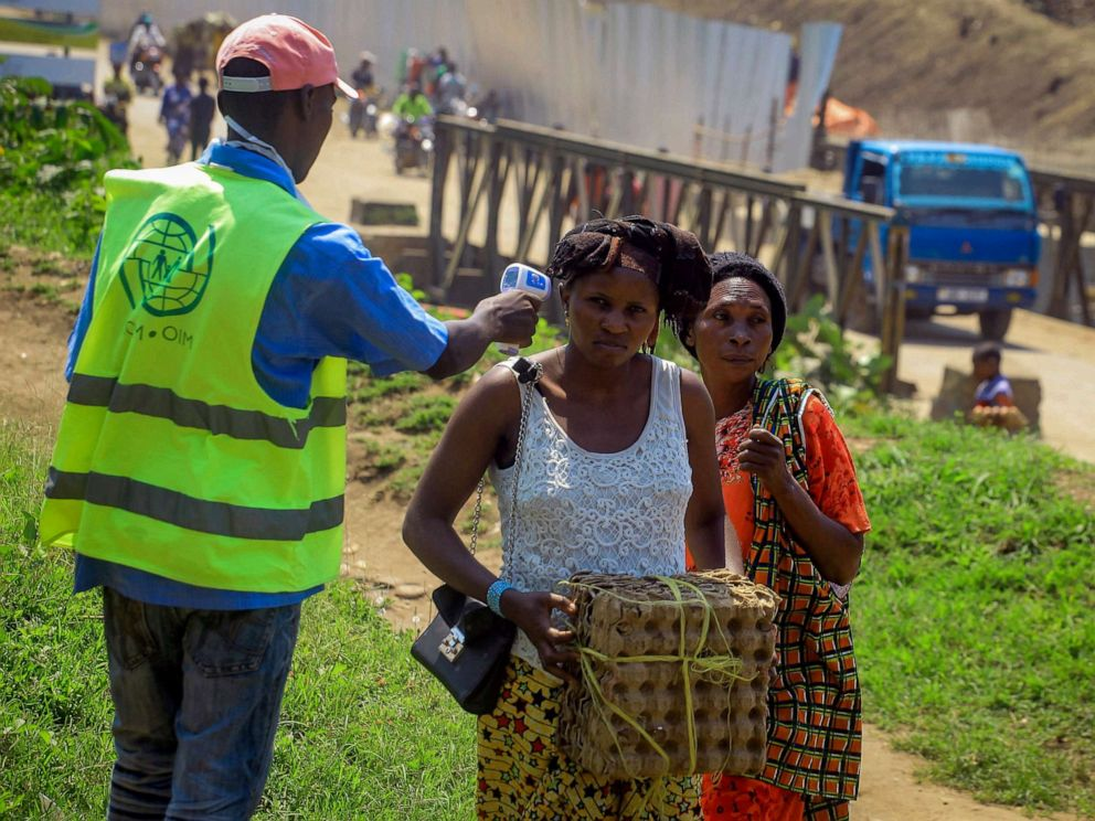 PHOTO: People crossing the border have their temperature taken to check for symptoms of Ebola, at the border crossing near Kasindi, eastern Congo, June 12, 2019, just across from the Ugandan town of Bwera.
