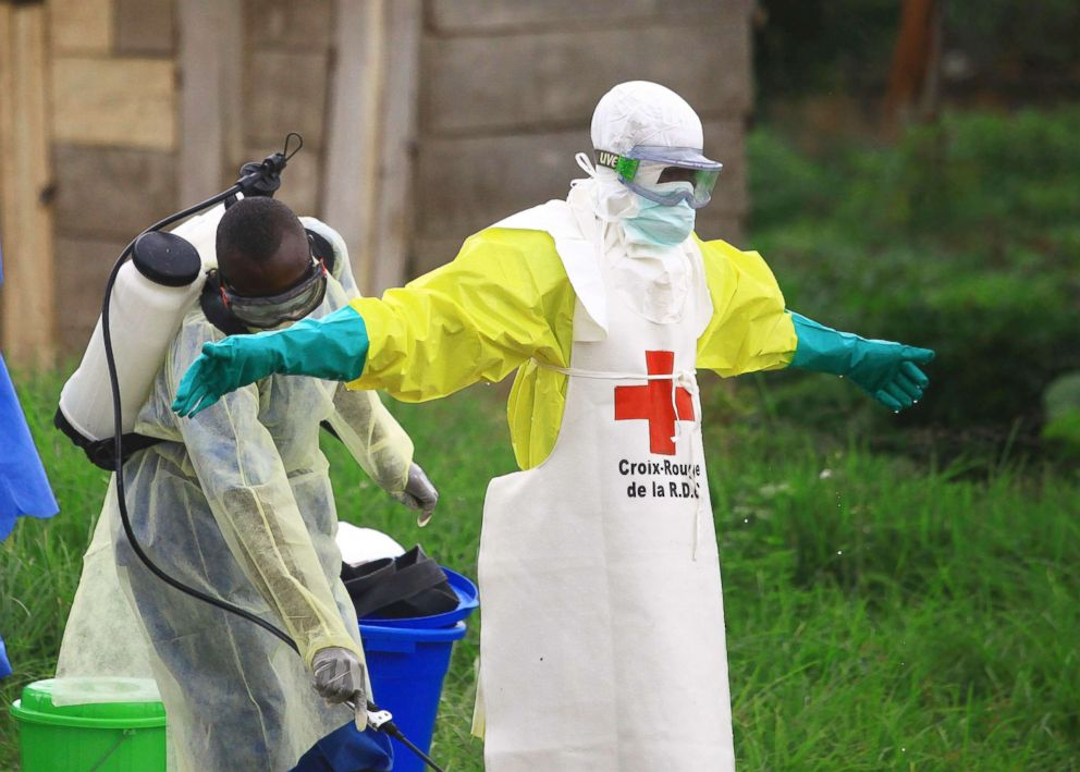 PHOTO: In this Sept 9, 2018, file photo, a health worker sprays disinfectant on his colleague after working at an Ebola treatment centre in Beni, Eastern Congo.