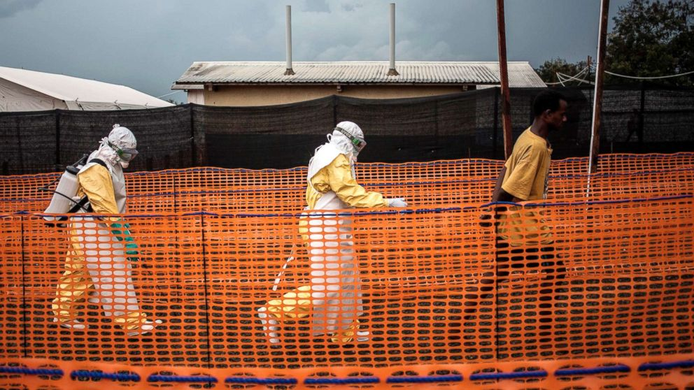 Health workers escort an unconfirmed Ebola patient at a newly build MSF (Doctors Without Borders) supported Ebola treatment centre in Bunia, Democratic Republic of the Congo, Nov. 7, 2018.