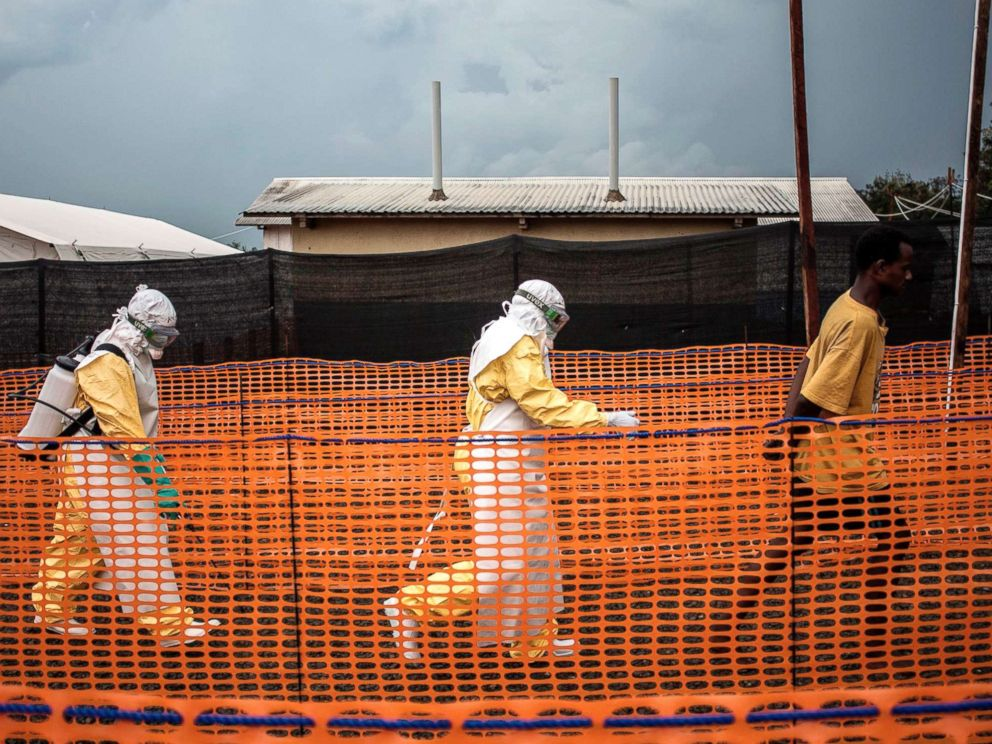 PHOTO: Health workers escort an unconfirmed Ebola patient at a newly build MSF (Doctors Without Borders) supported Ebola treatment centre in Bunia, Democratic Republic of the Congo, Nov. 7, 2018.