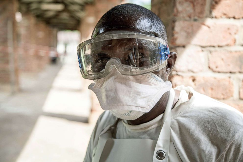 PHOTO: A health worker wears protective equipment as he looks on at Bikoro Hospital, the epicenter of the latest Ebola outbreak in the Democratic Republic of Congo, May 12, 2018.