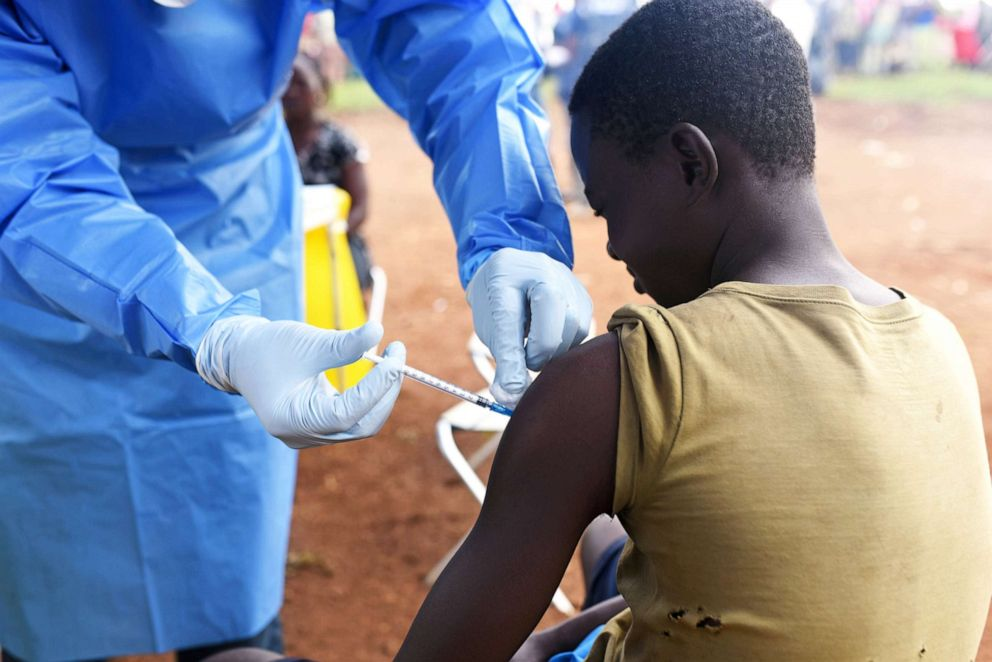 A Congolese health worker administers Ebola vaccine to a boy who had contact with an Ebola sufferer in the village of Mangina in North Kivu province of the Democratic Republic of Congo, Aug.18, 2018.