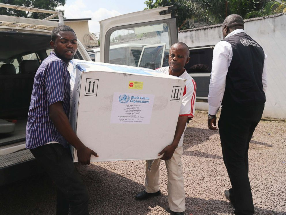 PHOTO: Congolese Health Ministry officials carry the first batch of experimental Ebola vaccines in Kinshasa, Democratic Republic of Congo, May 16, 2018.