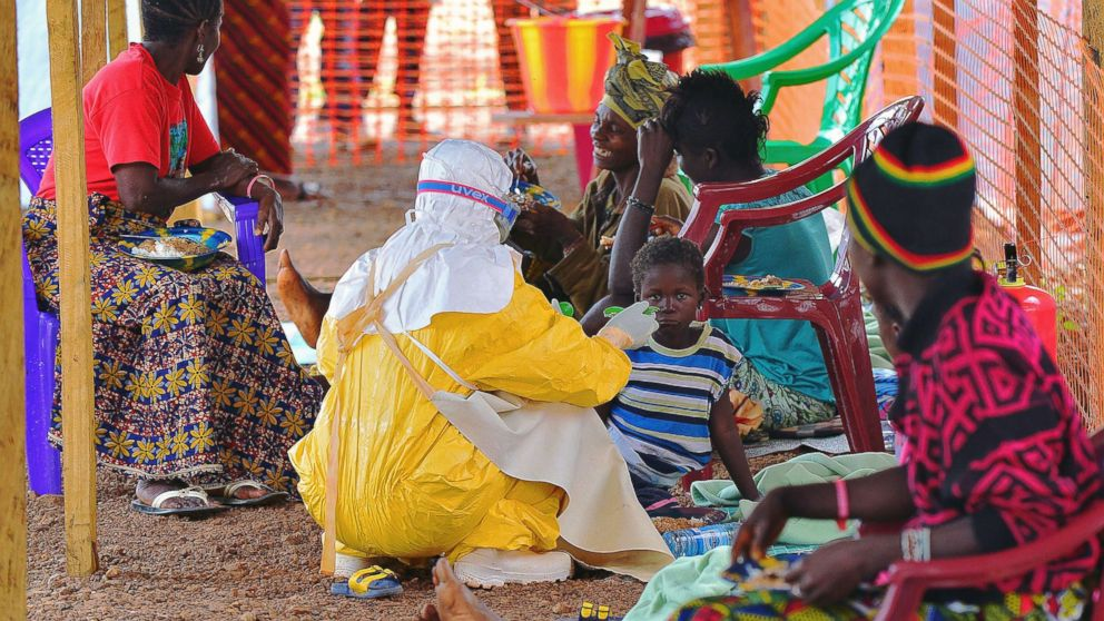 An MSF medical worker feeds an Ebola child victim at an MSF facility in Kailahun, on Aug. 15, 2014.