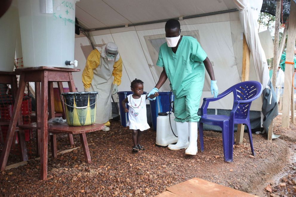 PHOTO: 22-year-old Isata is the youngest patient to be discharged from the Ebola treatment center in Kailahun district, Sierra Leone, on 12 August 2014.