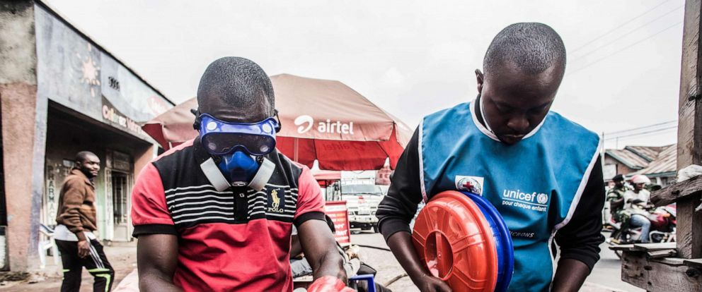 PHOTO: Health workers wear protective gear to mix water and chlorine in Goma, July 31, 2019.