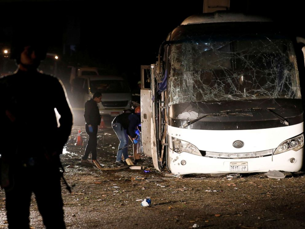 PHOTO: Police officers inspect a scene of a bus blast in Giza, Egypt, Dec. 28, 2018.