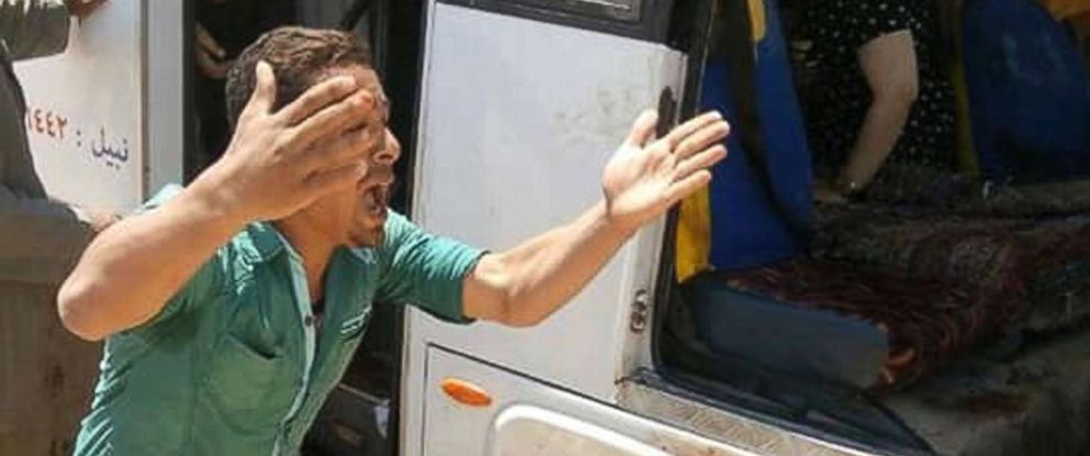 PHOTO: A man screams beside a bus carrying Coptic Christians which came under attack by Islamic militants outside Cairo, Friday, Nov. 2, 2018.