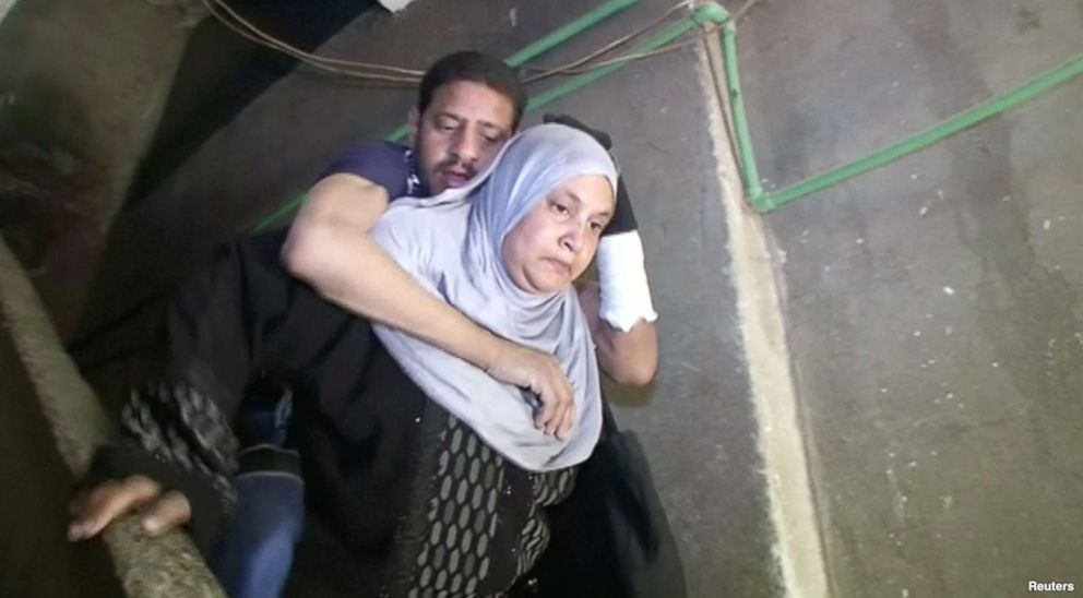 PHOTO: Heba Ragab carried her sick husband, Khaled al-Badawi, to vote in the Egyptian presidential election.
