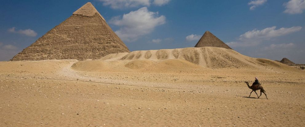 PHOTO: The Pyramid of Khafre with the Great Pyramid and Queens Pyramid in the background .