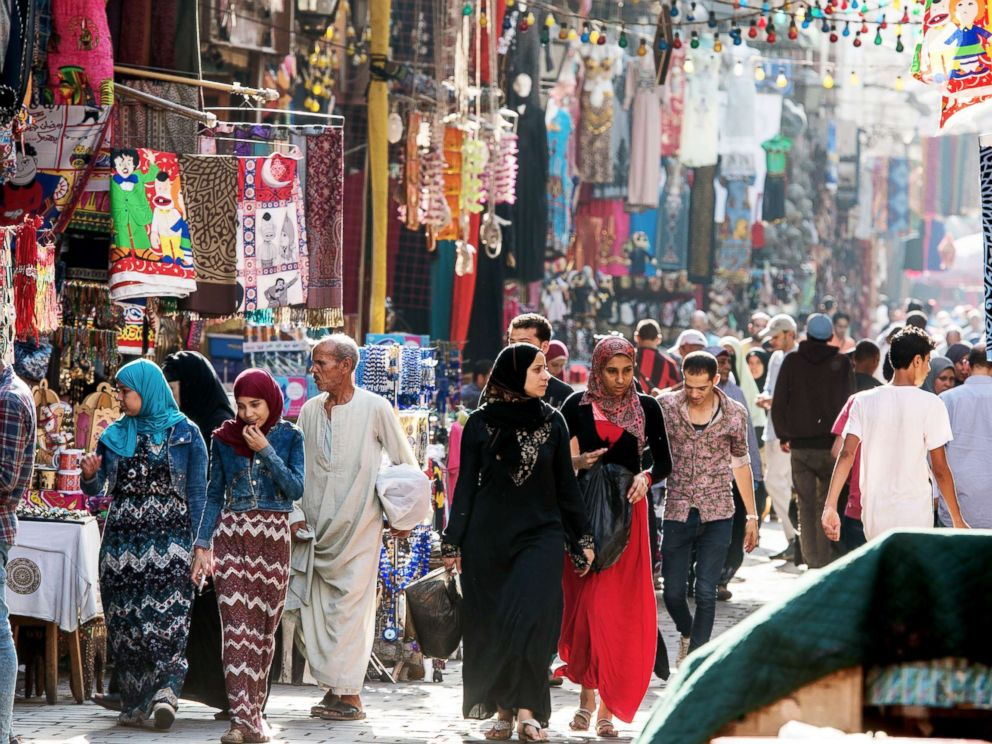 PHOTO: People walk through shops long an alleyway in an outdoor flea market in Cairo in this undated stock photo..