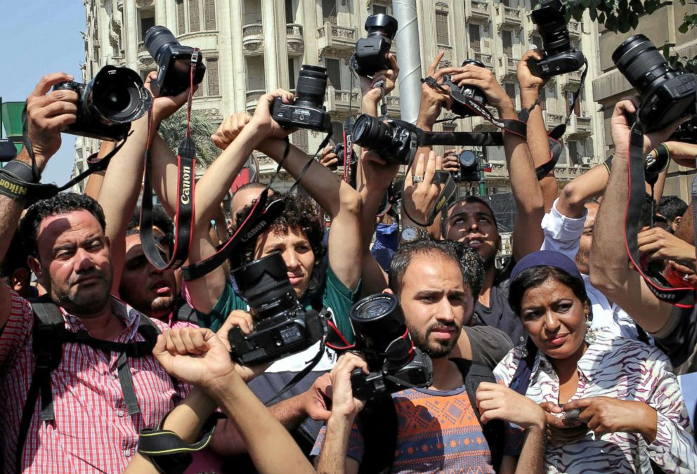 PHOTO: Egyptian journalists hold up their cameras outside the Egyptian Press Syndicate in downtown Cairo, Egypt, April 28, 2016.