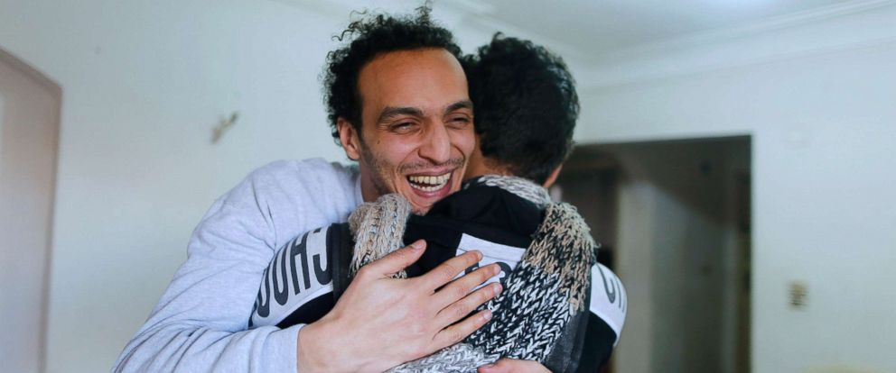 PHOTO: Mahmoud Abu Zaid, a photojournalist known as Shawkan, hugs a friend at his home in Cairo, Egypt, March 4, 2019, following his release after five years in prison.