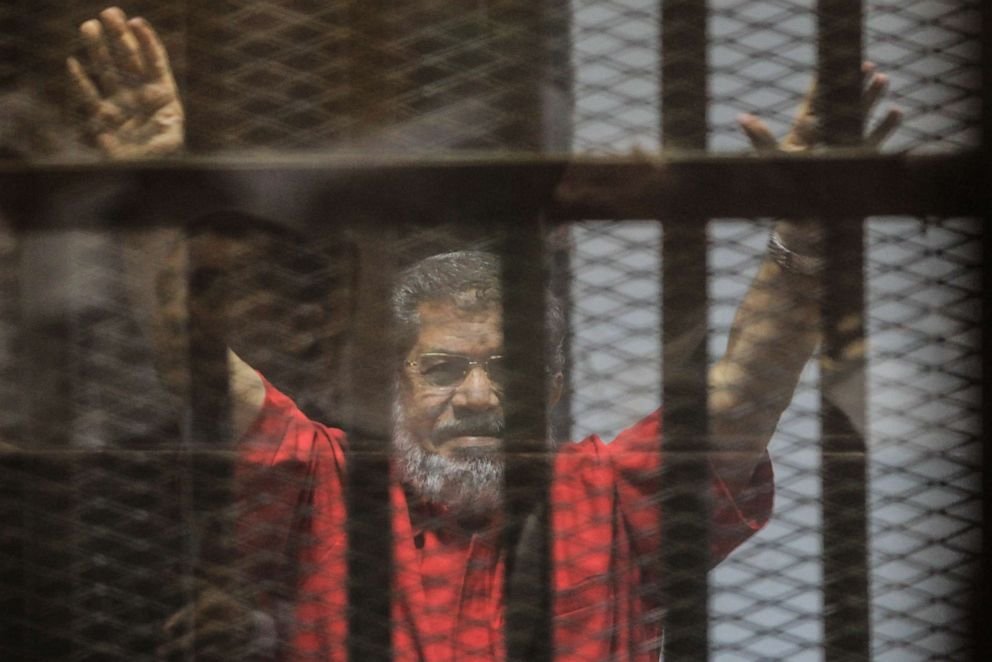 PHOTO: Ousted Egyptian President Mohammed Morsi gestures during a trial session on charges of espionage in Cairo, Egypt, June 18, 2016.