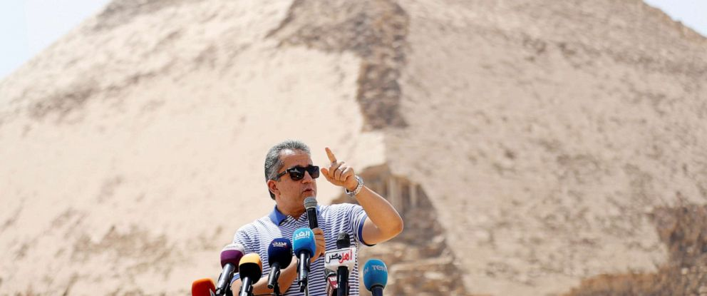 PHOTO: Egypts Antiquities Minister Khaled El-Enany speaks in front of the Bent Pyramid of Sneferu that was reopened after restoration work, in Dahshur, south of Cairo, July 13, 2019.