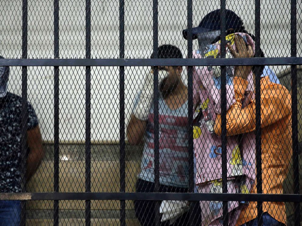 PHOTO: Eight Egyptian men convicted for inciting debauchery following their appearance in a video of an alleged same-sex wedding party on a Nile boat cover their faces in the defendants cage in a courtroom in Cairo, Egypt, Nov. 1, 2014.
