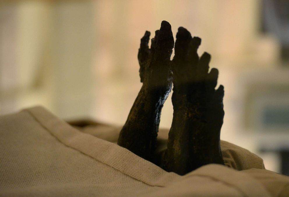 PHOTO: The feet of the linen-wrapped mummy of of the 18th dynasty Pharaoh Tutankhamun displayed in his climate-controlled glass case in his underground tomb in the Valley of the Kings on the west bank of the Nile river south of the capital Cairo.