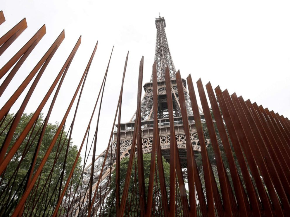 PHOTO: A security steel fence is pictured around the Eiffel Tower in Paris, June 14, 2018.