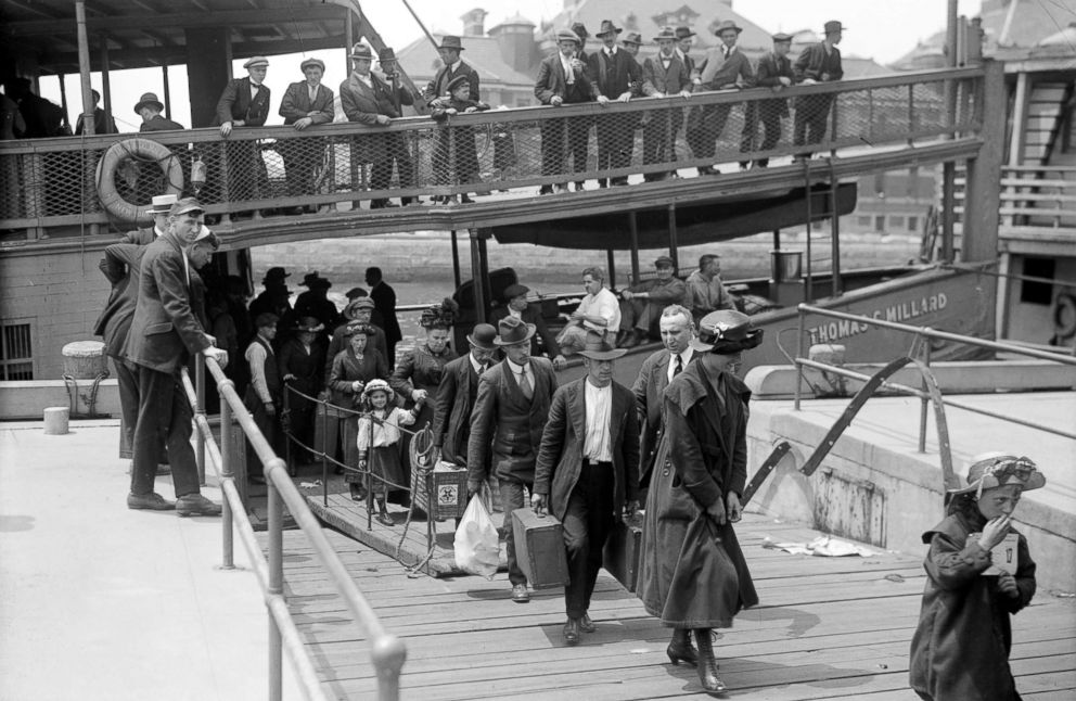 PHOTO: Newly arrived immigrants disembark from the passenger steamer Thomas C. Millard upon their arrival at Ellis Island, in New York, cicra 1905.