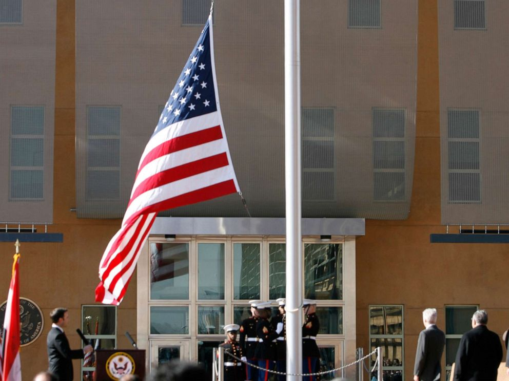 PHOTO: The US flag is raised during at the US embassy in the Green Zone, Jan. 5, 2009 in Baghdad, Iraq.