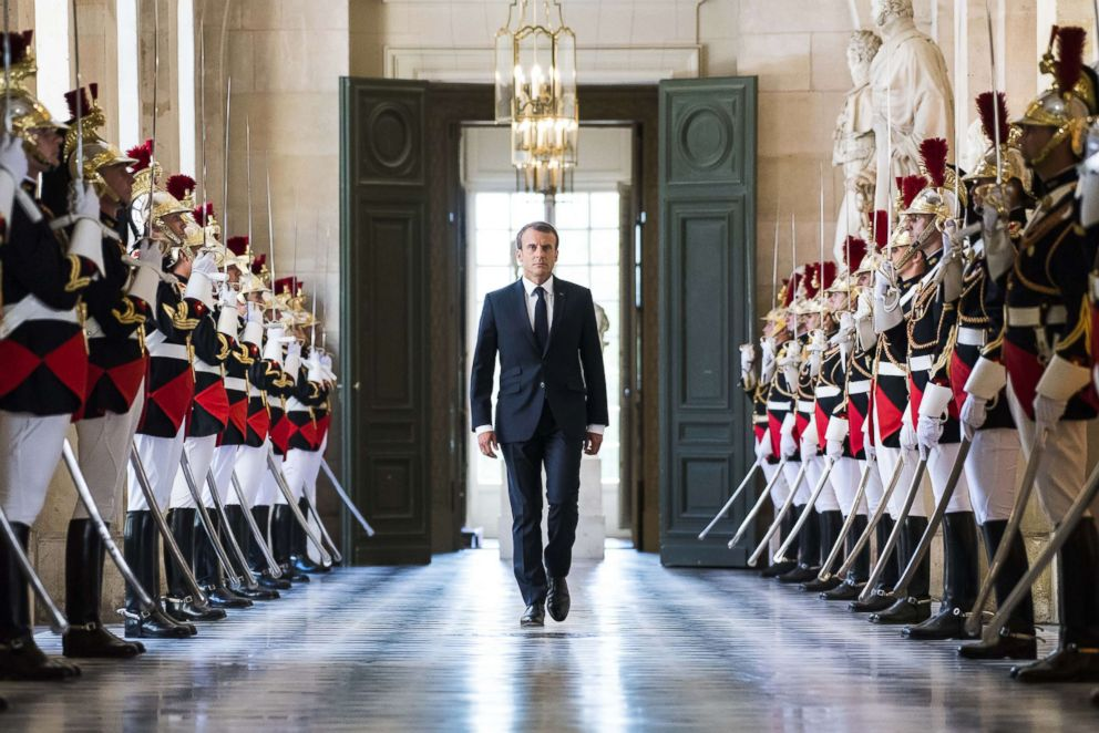 PHOTO: French President Emmanuel Macron walks through the Galerie des Bustes to access the Versailles Palaces hemicycle for a special congress gathering both houses of parliament in the palace of Versailles, outside Paris, July 9, 2018.