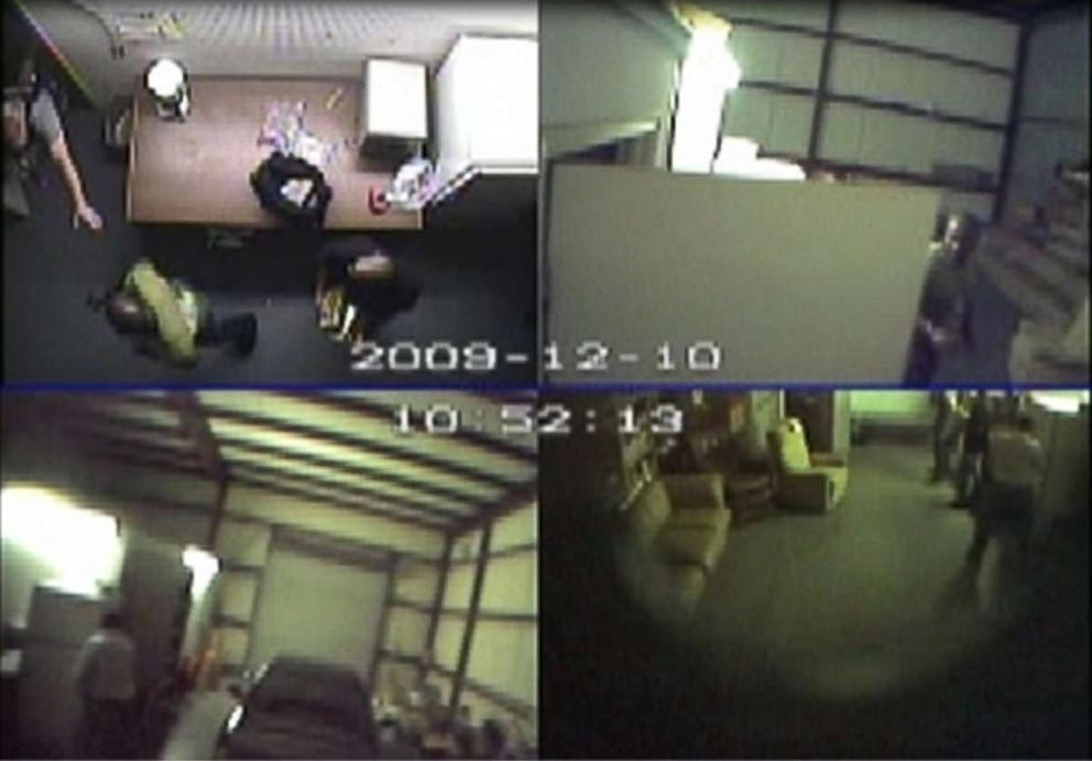 PHOTO: Surveillance video from Dec. 10, 2009, shows a police officer storming through a door inside the warehouse after James Mack tested the cocaine he had just been given.