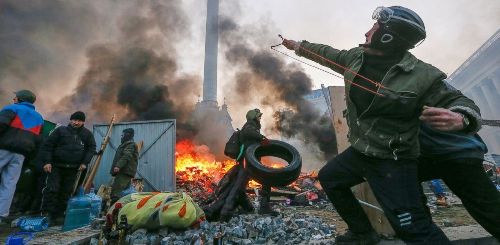 PHOTO: A protester uses a catapult during clashes with riot police in downtown Kiev, Ukraine, Feb. 19, 2014.