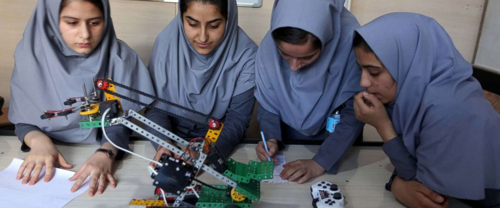 PHOTO: Afghan school girls test robot vehicles at a school in Herat, Afghanistan, July 4, 2017.