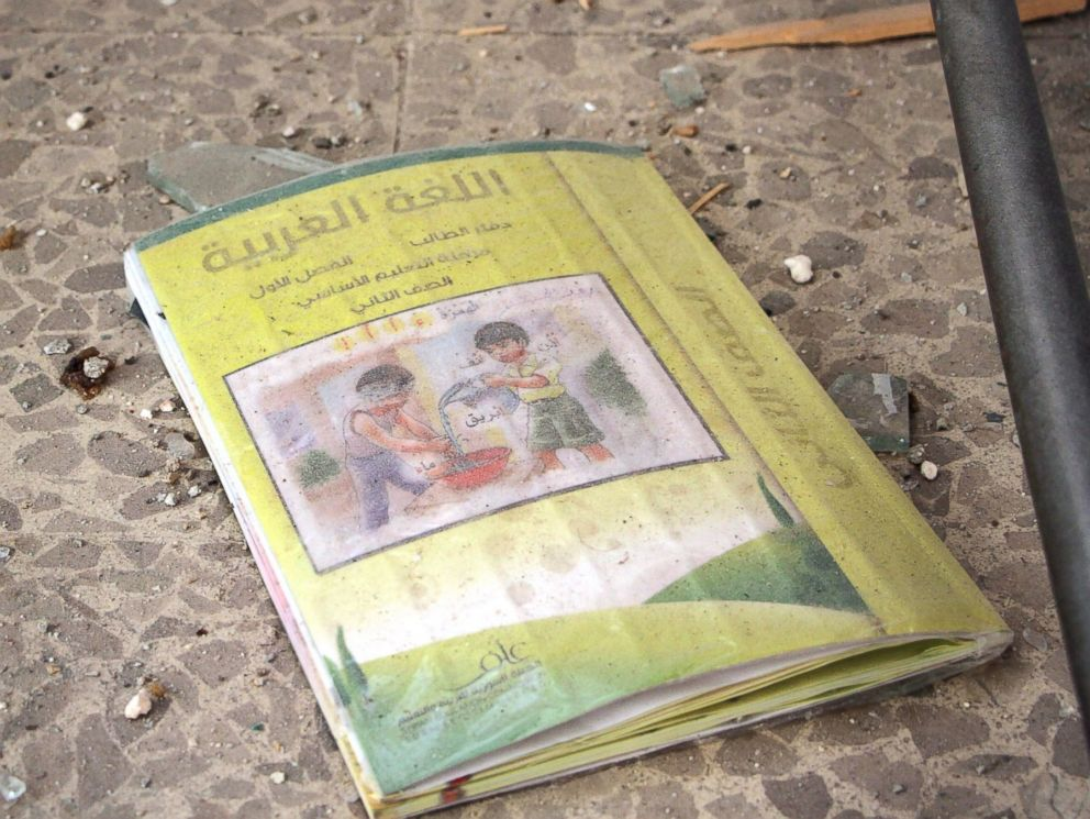 PHOTO: An Arabic language book lays on the ground at a school that was bombed a day earlier in rebel-held Idlib, Syria, Oct. 27, 2016.