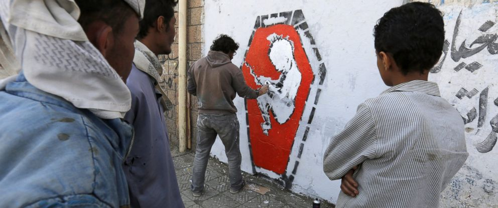 PHOTO: Yemeni artist Murad Subay sprays graffiti on a wall in protest against the ongoing conflict and the worsening economic situation in the war-affected country, in Sana?a, Yemen, Oct. 20 2016.