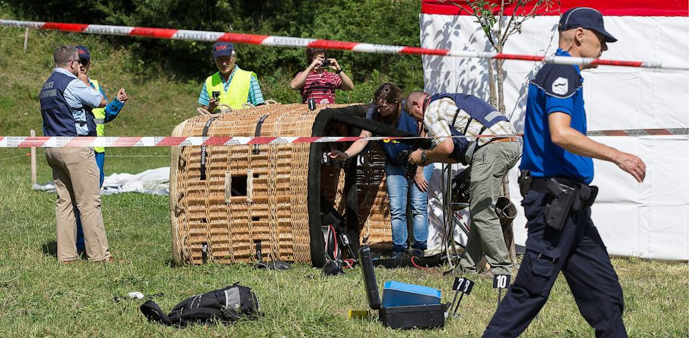 PHOTO: Swiss police officers inspect a hot air ballon after it crashed