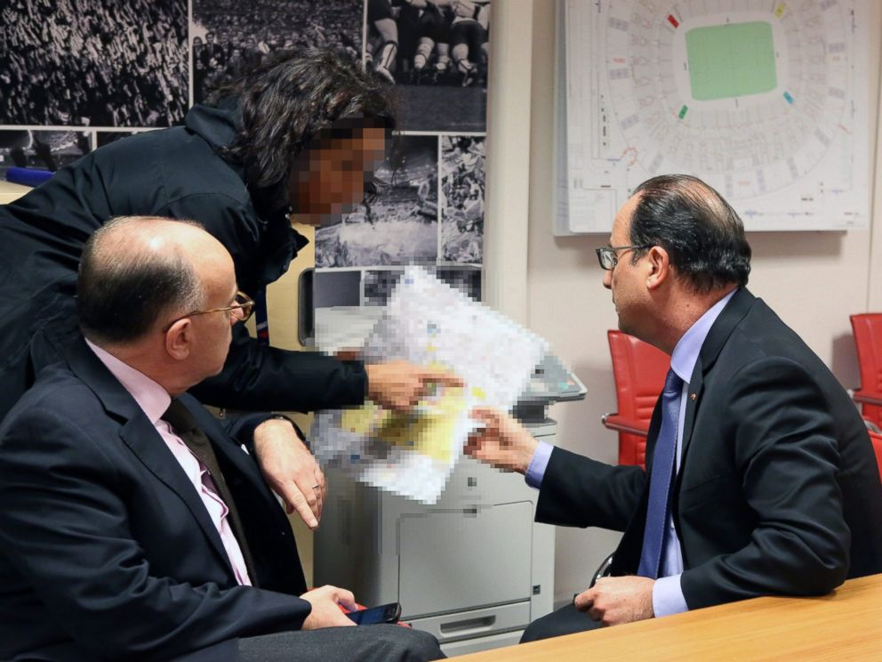 PHOTO: French president Francois Hollande and French Interior Minister Bernard Cazeneuve are pictured at Stade de France, near Paris, Nov. 13 2015 at the moment of the attacks in Paris.