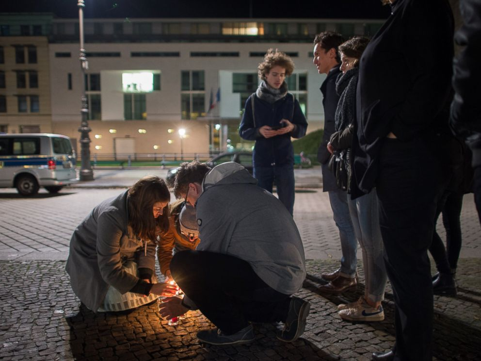 PHOTO: People light candles in tribute to the victims of the Paris attacks outside the French embassy in Berlin on Nov. 13, 2015.