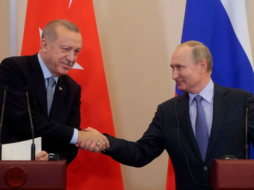 PHOTO: Russian President Vladimir Putin shakes hands with his Turkish counterpart Recep Tayyip Erdogan during a joint press conference following their talks in the Black sea resort of Sochi on Oct. 22, 2019.