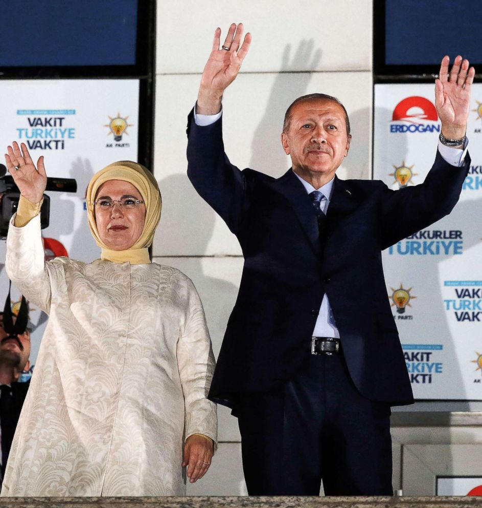 PHOTO: Turkish President Tayyip Erdogan and his wife Emine Erdogan greet supporters gathered above a balcony at the headquarters of the AK Party in Ankara, June 24, 2018 as they celebrate Erdogan winning five more years.