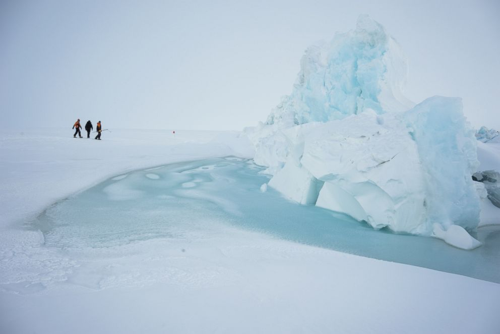 PHOTO: Scientists and base staff walk through pressure ridges in sea ice just outside of Scott Base the New Zealand Antarctic research facility near Mount Erebus, Nov. 21, 2015.