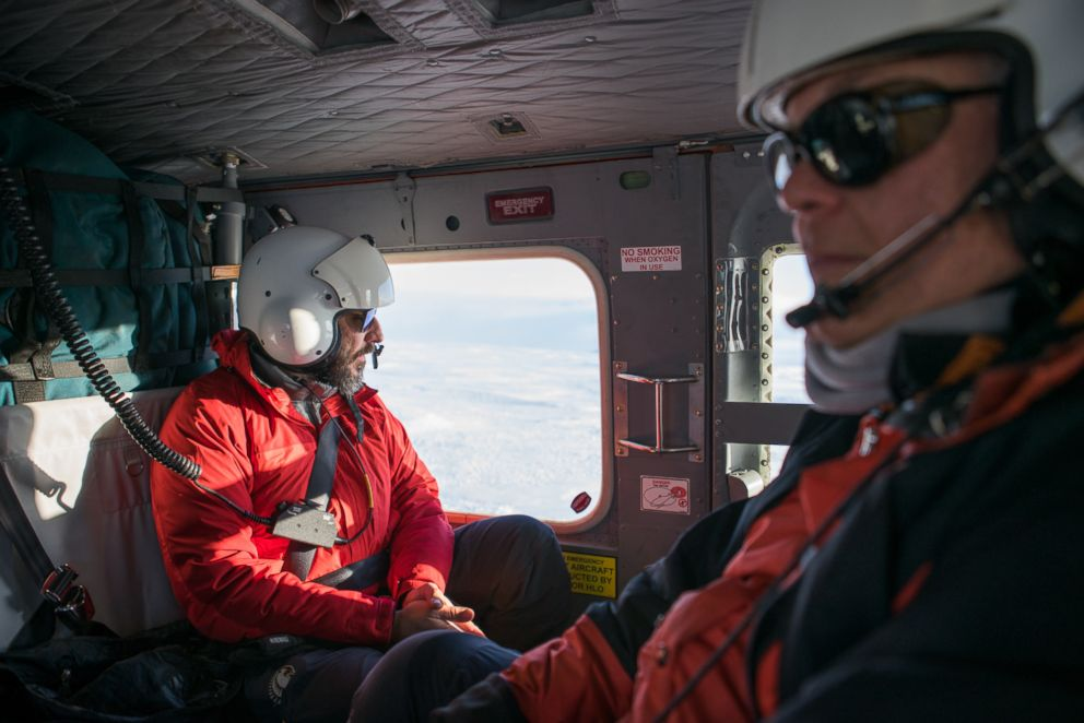 PHOTO: Dr. Phil Wannamaker (right) and Paul Bedrosian (left) en route to an installation site.