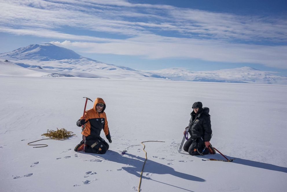 PHOTO: Dr. Martyn Unsworth and Dr. Virginie Maris practice mountaineering skills on the Ross Ice shelf. Here they are learning how to rescue someone who has fallen into a crevasse.