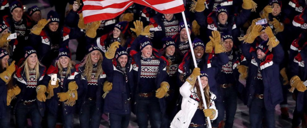 PHOTO: Erin Hamlin carries the flag of the United States during the opening ceremony of the 2018 Winter Olympics in Pyeongchang, South Korea, Feb. 9, 2018.