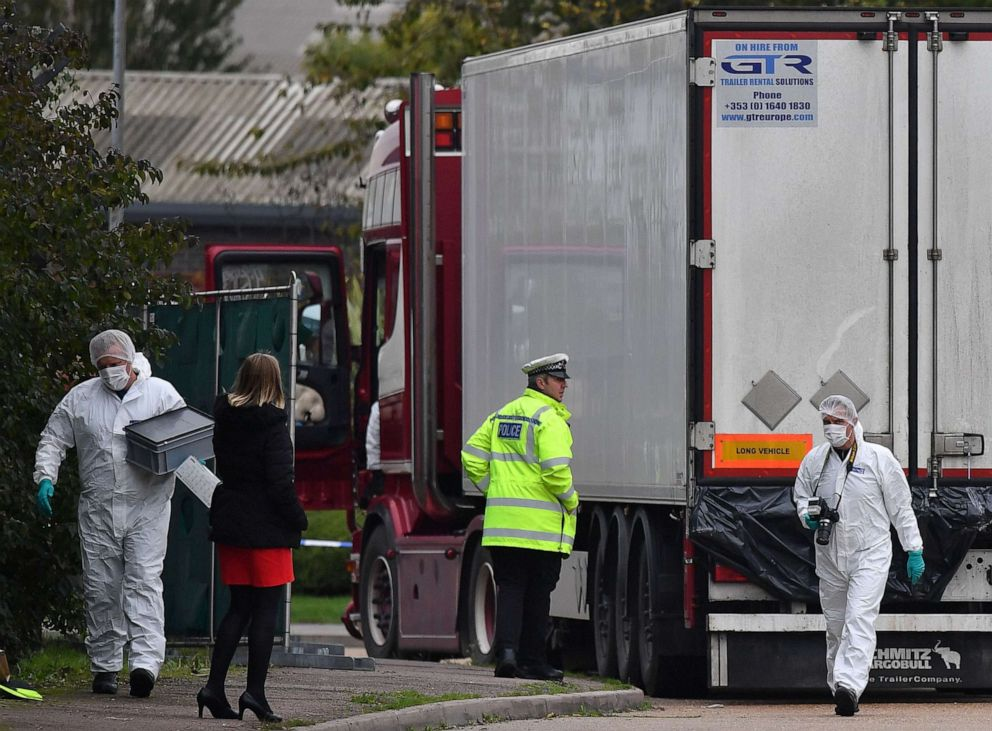 PHOTO: British Police forensics officers work on lorry, found to be containing 39 dead bodies, at Waterglade Industrial Park in London, Oct. 23, 2019.