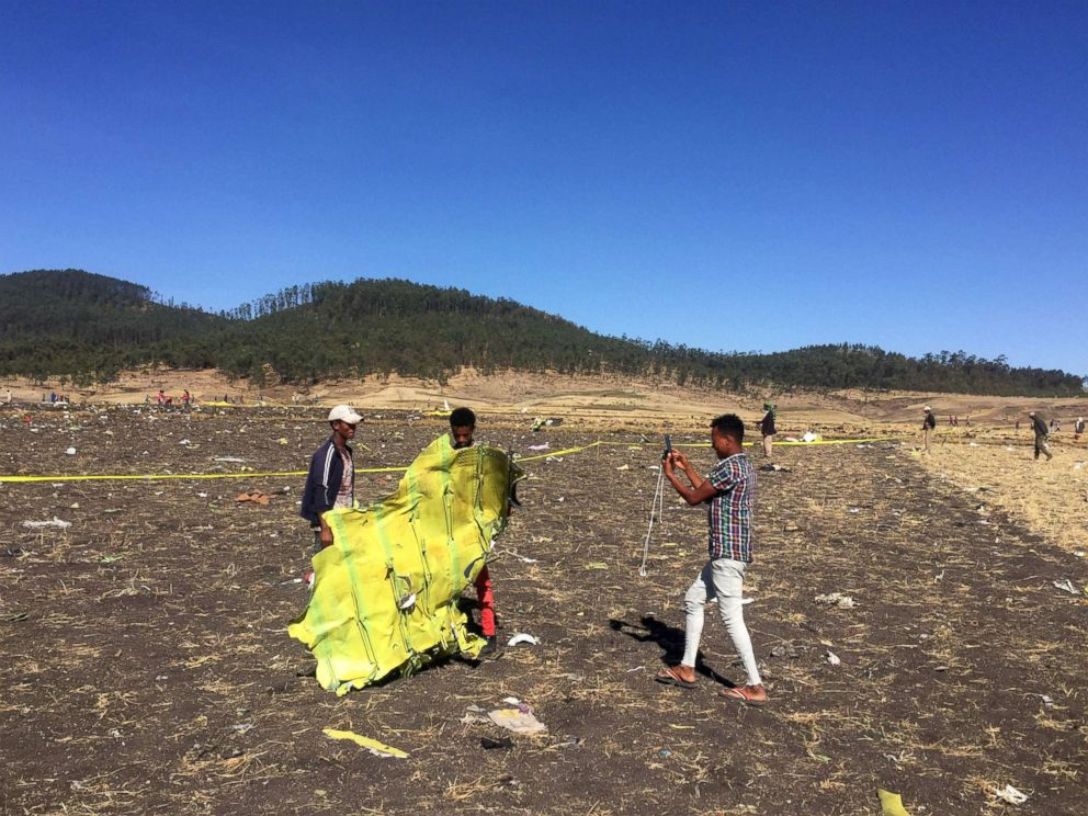 PHOTO: A civilian takes a photograph of the wreckage at the scene of the Ethiopian Airlines Flight ET 302 plane crash, near the town of Bishoftu, southeast of Addis Ababa, Ethiopia, March 10, 2019.