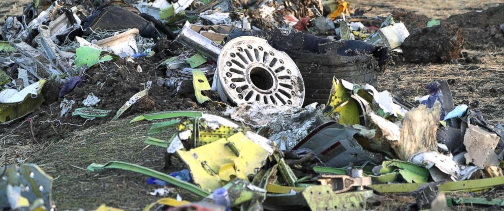PHOTO: Parts of the landing gear lay in a pile after being gathered by workers during the continuing recovery efforts at the crash site of Ethiopian Airlines flight ET302 on March 11, 2019, in Bishoftu, Ethiopia.